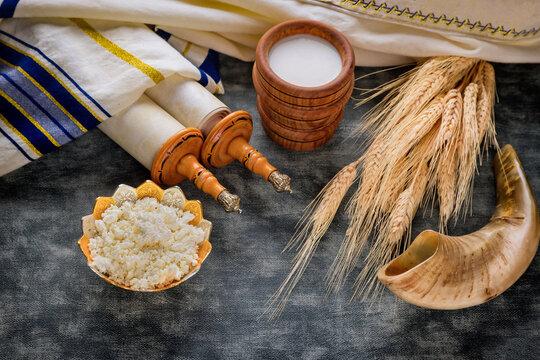 Torah and kippah on celebration Jewish Holiday Shavuot for Kosher dairy product