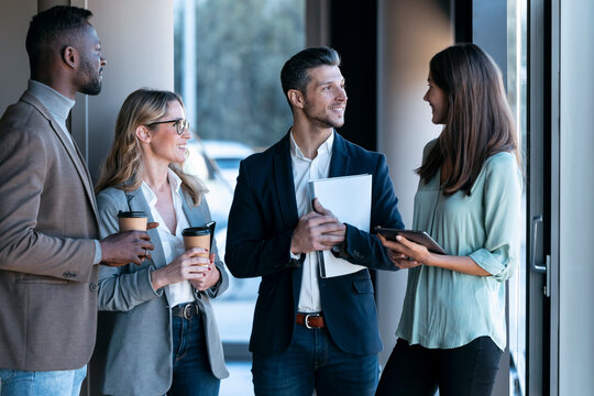 Team having discussion while standing in office