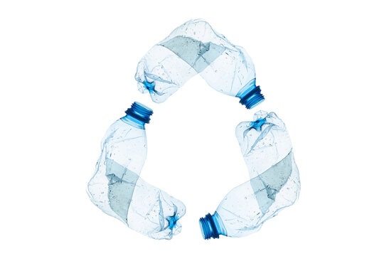 Recycle symbol made of used plastic bottles isolated on white background
