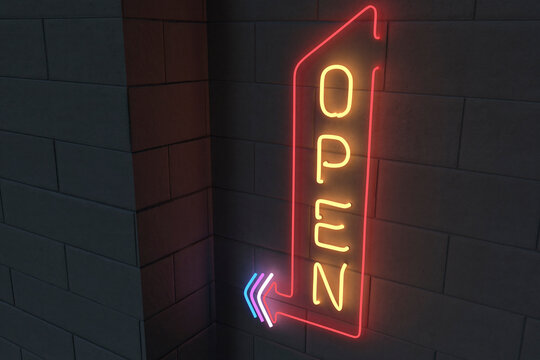 Illuminated open sign on black brick wall