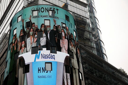 A screen displays actor and businesswoman Jessica Alba  during the IPO of The Honest Company at the Nasdaq Market site in New York