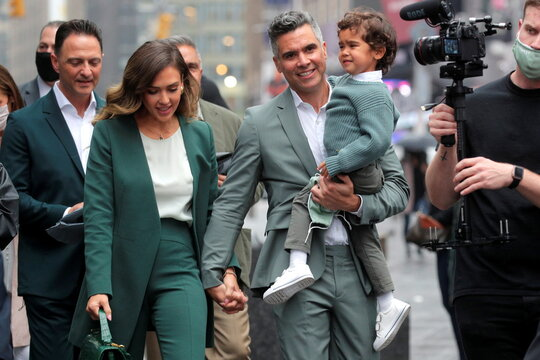 Actor and businesswoman Jessica Alba walks with her husband, film producer Cash Warren, during the IPO of The Honest Company in New York