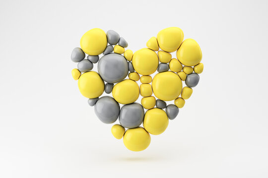 Three dimensional render of floating heart made of gray and yellow spheres