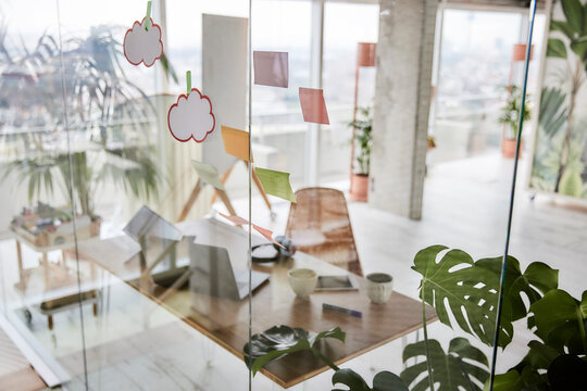 Adhesive notes on glass wall at office