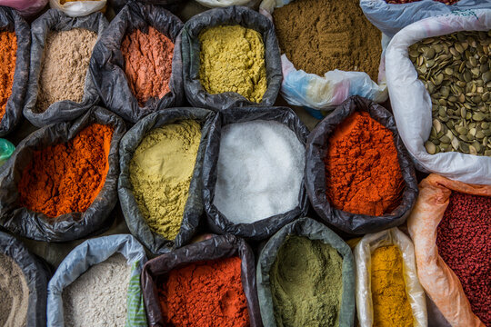 Bags of colorful spices at the Otavalo Market in Otavalo, Ecuador.