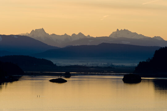 Sunrise from The Bluffs overlooking Puget Sound and the snow-covered Cascade Mountains. Whidbey Island, WA.