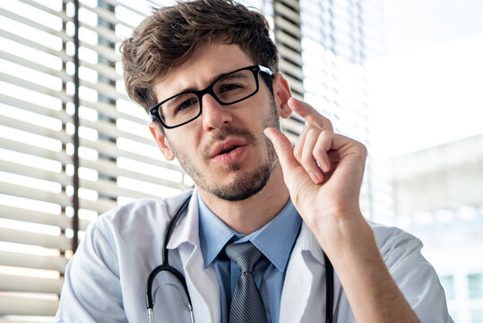 Caucasian male doctor looking at camera explaining patient in video call meeting, online medical consultation and telehealth concepts