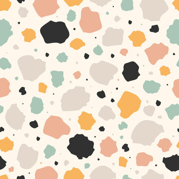 Seamless pattern with abstract shapes in pastel colors. Terrazzo imitation.