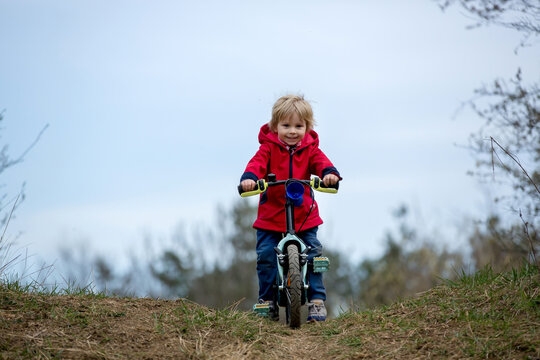 Little boy, learning how to ride a bike in the park