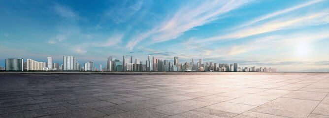 Panoramic skyline and buildings with empty space dark concrete square floor. Sunset over the city view. City urban Landscape.