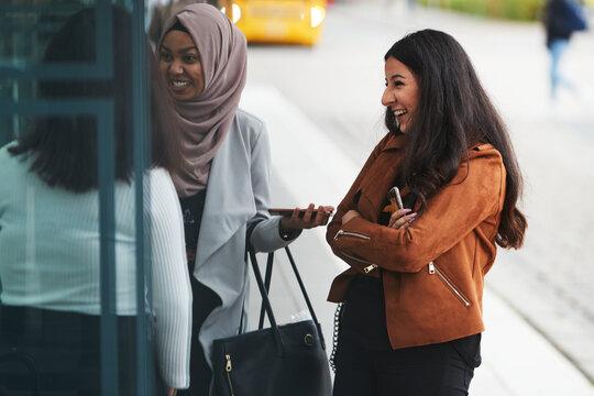 Smiling female friends talking together