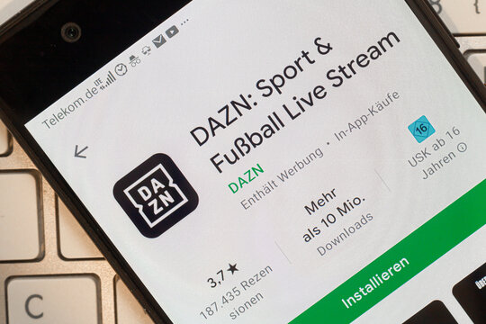 Neckargemuend, Germany: May 6, 2021: app icon of the sport network DAZN in an app store on phone screen top view, Illustrative Editorial.