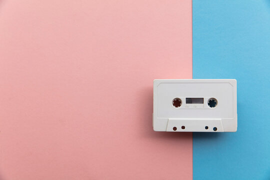vintage white cassette tape on a blue and pink background
