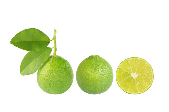 Green lime with leaf and lime with half lime isolated on white background, clipping path included.