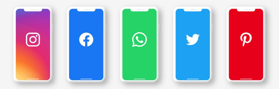 Popular social media logos on smartphone device set : Instagram, Facebook, Whatsapp, Twitter, Pinterest. Isolated neomorphism telephone whith logo on white background. Vector illustration.