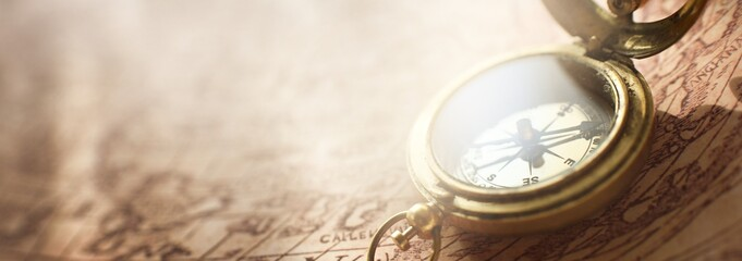 Obraz Retro styled golden antique compass (sundial) and old white nautical chart close-up. Vintage still life. Sailing accessories. Travel, navigation concepts, collecting, souvenir, gift, graphic resource - fototapety do salonu