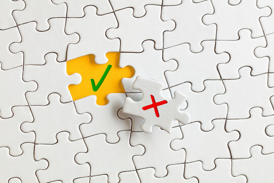 Check mark (right) and cross mark (wrong) on the missing puzzle pieces. To discover or expose the right or truth