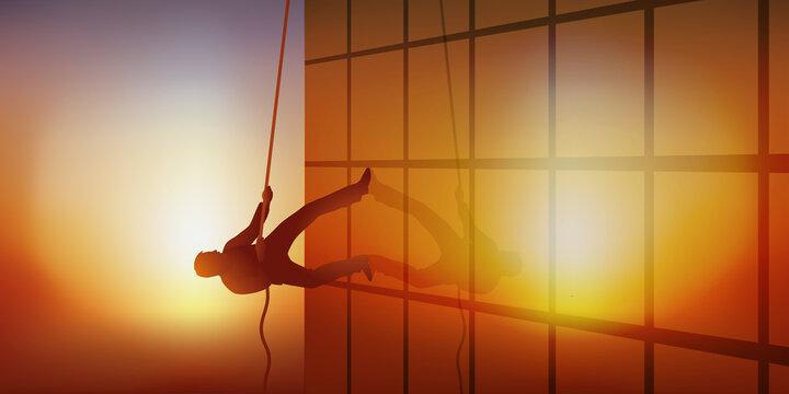 Concept de l'ambition professionnelle avec un homme qui escalade la façade d'un immeuble en grimpant à une corde.