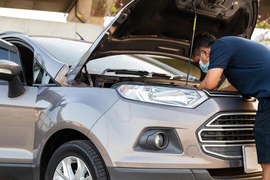 car service, repair, maintenance and people concept - man repiar auto mechanic outdoor.