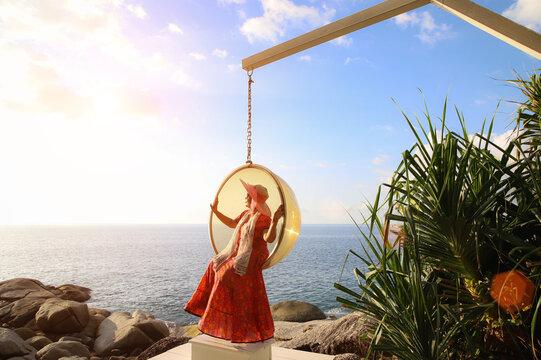 Asian women enjoying beach vacations after the coronavirus epidemic resolves.