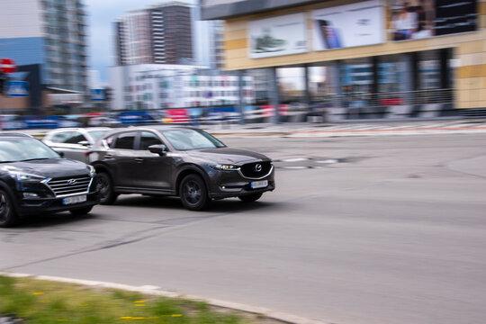 Ukraine, Kyiv - 26 April 2021: Gray Mazda CX-5 car moving on the street. Editorial