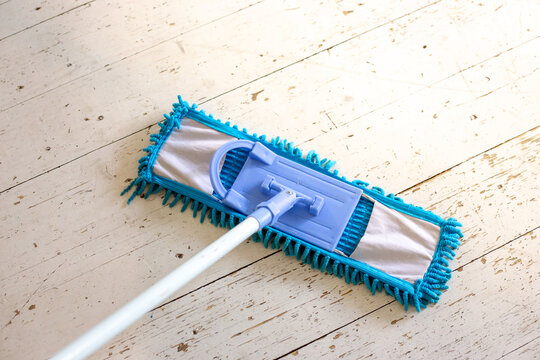 With my mop on the white wood floor