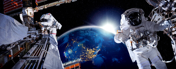 Fototapeta Astronaut spaceman do spacewalk while working for space station in outer space . Astronaut wear full spacesuit for space operation . Elements of this image furnished by NASA space astronaut photos. obraz
