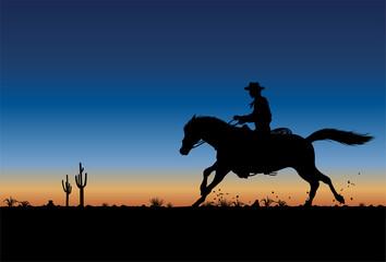Fototapeta Silhouette Of Cowboy Riding Horse At Sunset