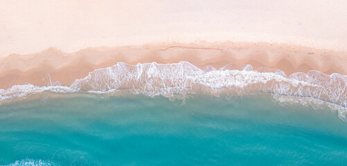 Panorama top view of blue aqua sea and white sand. Capture sea wave and beach in summer by drone.