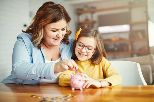 piggy bank mother daughter money savings coin finance child family happy investment