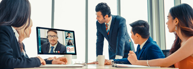Obraz Video call group business people meeting on virtual workplace or remote office. Telework conference call using smart video technology to communicate colleague in professional corporate business. - fototapety do salonu