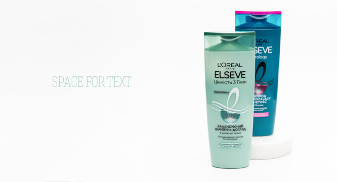 Rivne, Ukraine, 05/08/2021, Loreal Elseve shampoo from two bottles, empty space for text, banner