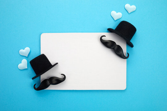 Happy Father's Day greeting card of white frame with decoration. Includes mustache, hat and hearts.