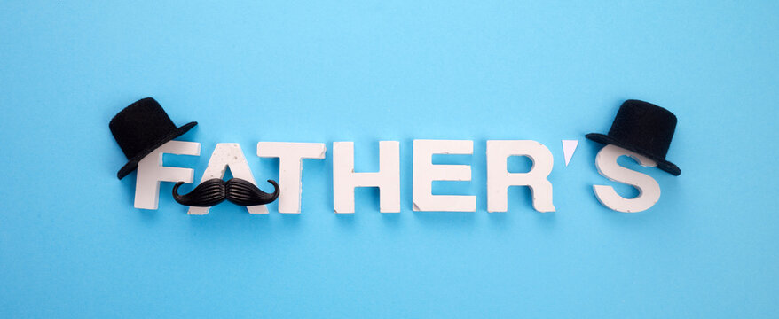 Father's Day banner with mustache and hats on blue background