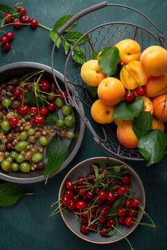 Overhead view of fresh summer fruits on reen surface