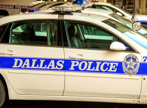 Dallas, Texas, USA - September 2009: Side view of a police department patrol car parked outside a police station