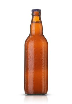 glass bottle with beer in drops