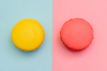 two color macaron cakes on a two paper color background