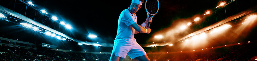 Fototapeta Tennis player with racket in white t-shirt. Man athlete playing on grand arena with tennis courts. obraz