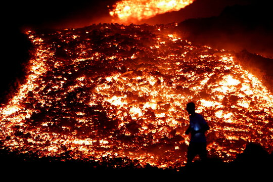 Red hot lava flows during an eruption of the Pacaya volcano at San Vicente de Sales municipality in the Escuintla region