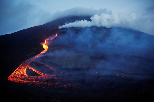 Streams of red hot lava are seen during an eruption of the Pacaya volcano at San Vicente de Sales municipality in the Escuintla region