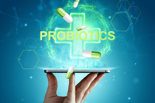 Medical cross hologram and inscription probiotics. The concept of diet, intestinal microflora, microorganisms, healthy digestion.