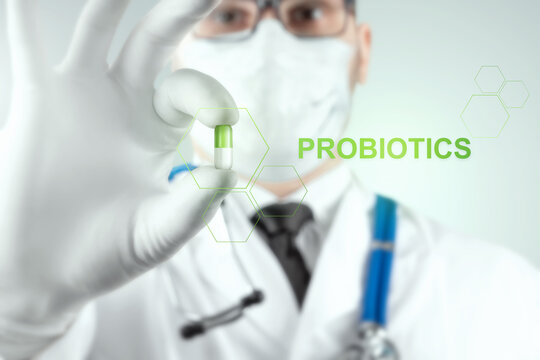 Close-up doctor holds a pill, tablet in his hand. Probiotics concept, diet, ditox, intestinal microflora.
