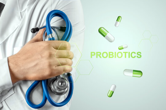 Doctor close-up image of pills and inscription probiotics. The concept of diet, intestinal microflora, microorganisms, healthy digestion.