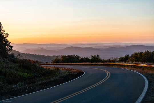 Fall autumn season with sunrise at winding Highland Scenic highway 150 road in West Virginia Monongahela National Forest Appalachian mountains
