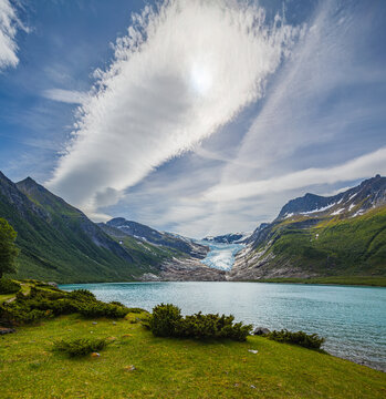 Landscape with mountains, a tongue of the Svartisen glacier and a glacial lake in Nordland, Norway