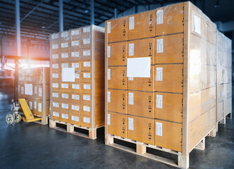 Interior of Storage Warehouse. Stacked of Package Boxes Wrapped Plastic Flim on pallet rack. L-Shape Pallet Corrugated Paper Cardboard Angle Corner Edge Protector. Shipping Warehouse Logistics.