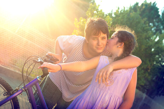 Young kids outdoors kissing