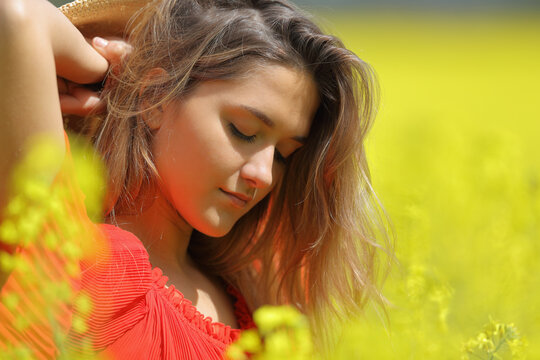 Portrait of a beauty woman in red in a yellow field