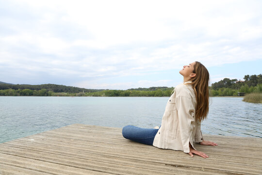 Woman sitting in a pier breathing fresh air